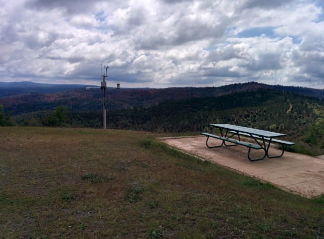 Picnic table next to the lookout tower with a great view of the surrounding area