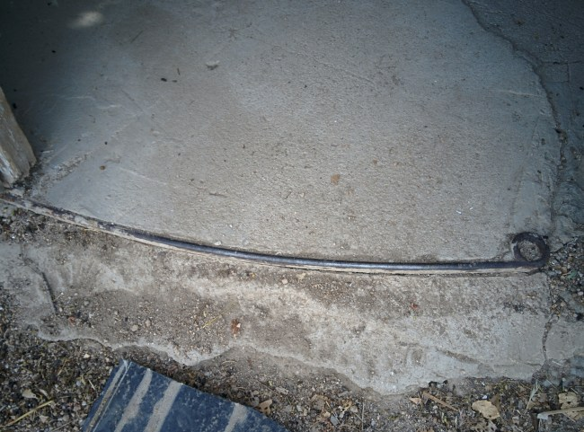 An Old Leaf Spring as a Form For A Concrete Foundation