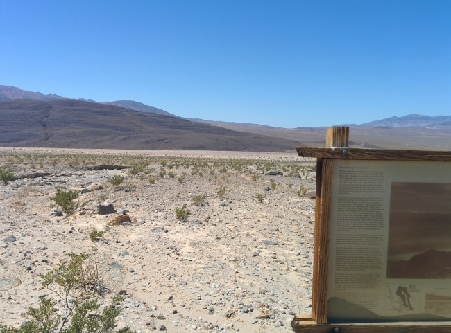 looking around the Lake Manly sign at the dry basin that is now Death Valley