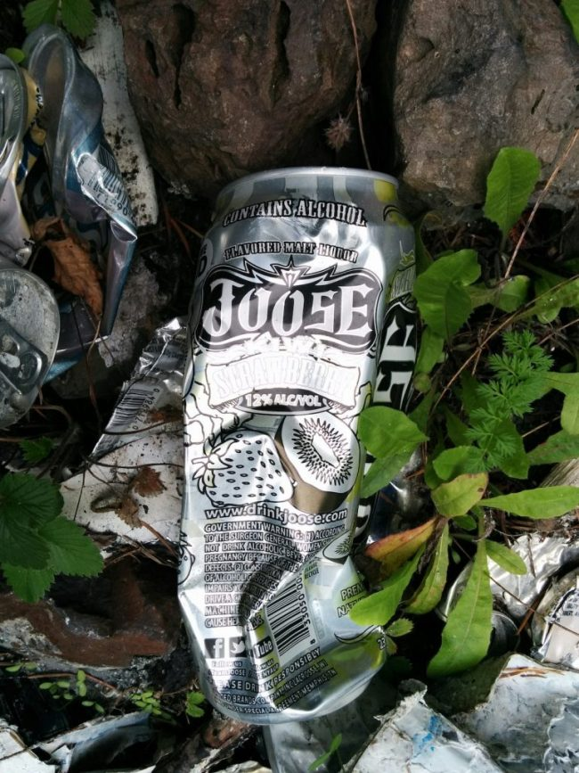 a littered can of Joose malt liquor