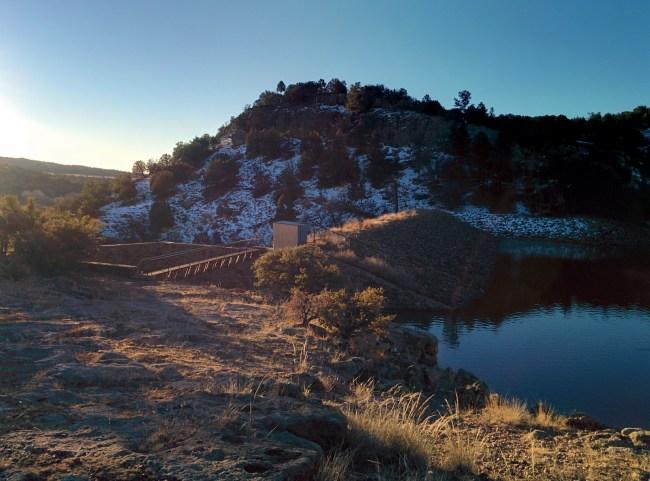Bear Canyon Lake dam with snow