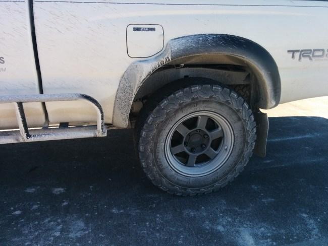 black wheels coated in white gypsum paste