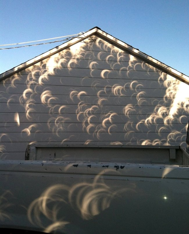 eclipse shadows on the side of a house