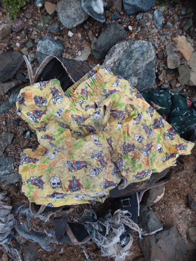 An immigrant child's underwear found in a rotting backpack