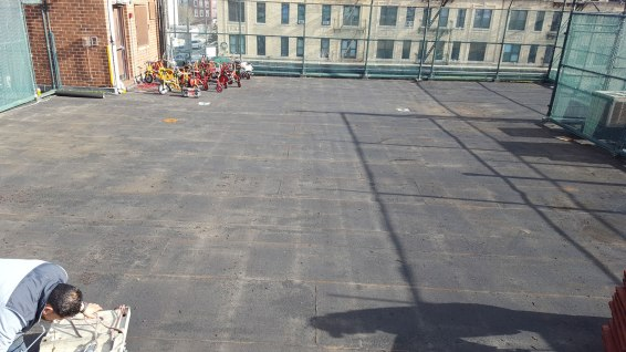 Preparing Rooftop Playground for Rubber TIle Playground Surfacing Brooklyn NY | adventureTURF