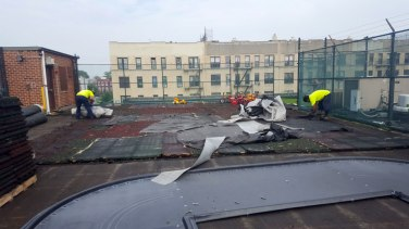 Removing Rubber Playground Tiles on Rooftop Daycare Playground in Brooklyn NY | adventureTURF