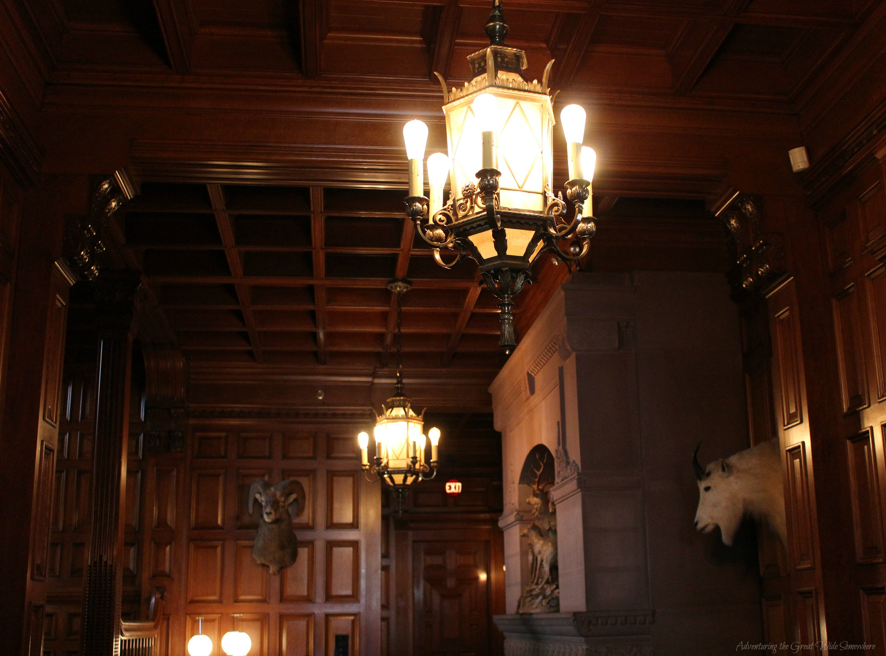 First Floor Entry to Craigdarroch Castle, Featuring Warm Wooden Walls and Intricate Paneling