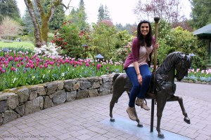 Nadya on the Merry Go Round Horse at Butchart Gardens
