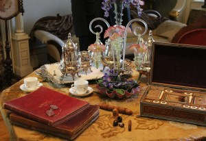 Sitting Room Details at Craigdarroch Castle, Including a Tea Set, Books and Games