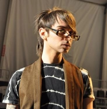 Christian Siriano looking pensive backstage before his first runway show at NYFW