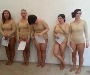 women in pale leotards at imitation of christ fashion show