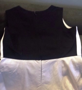 the back of the dress is color blocked in ponte knit for comfort and fit