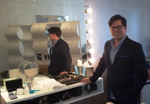 Chrisitan Zamora posing near the mirror in his studio