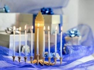 By LCRP Royalty-free stock photo ID: 498062548 Beautiful Chanukah decorations in blue and silver with gifts and dreidels and a Chanukiah with nine Chanukah candles for the Jewish holiday Hanukkah with copy space.