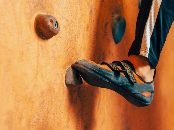 Male foot on climbing wall