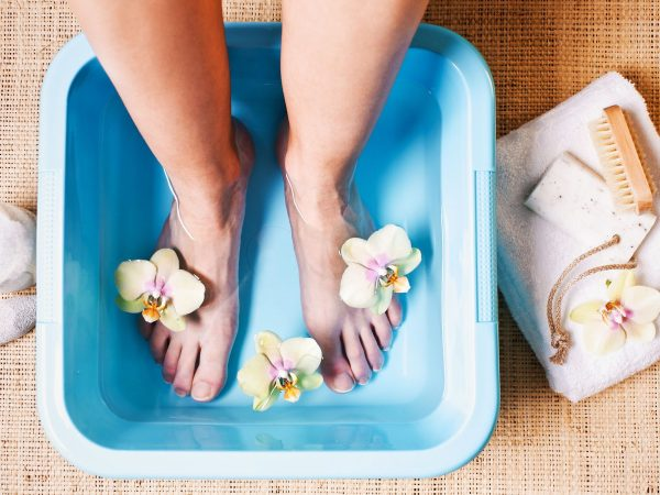 Detail photograph of a woman taking a Foot Bath