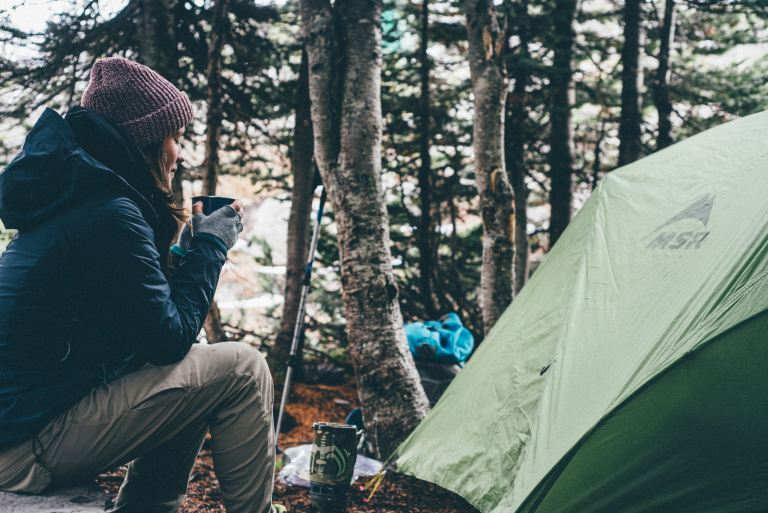 girl camping in the forest