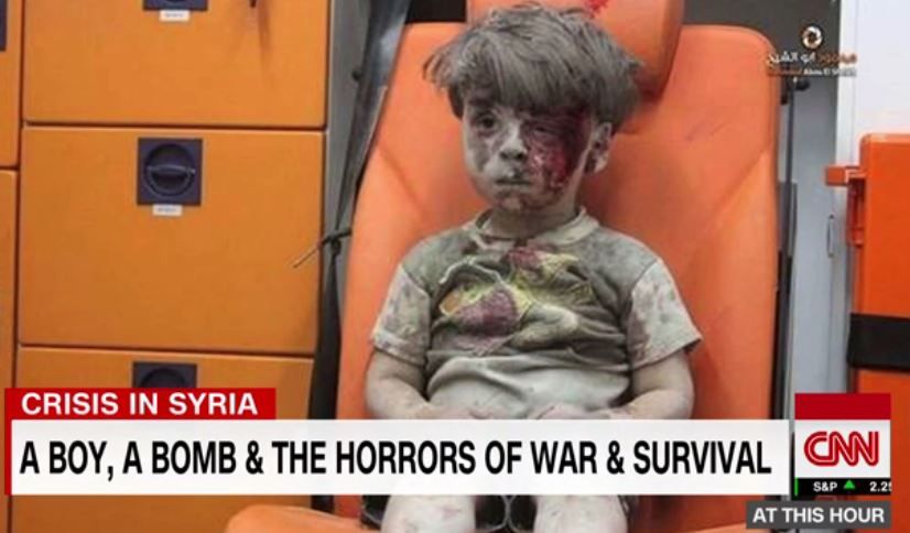 Image result for five-year-old Omran Daqneesh in Aleppo, Syria, sitting in that ambulance, silent and in shock, trying to wipe the blood from his hands.