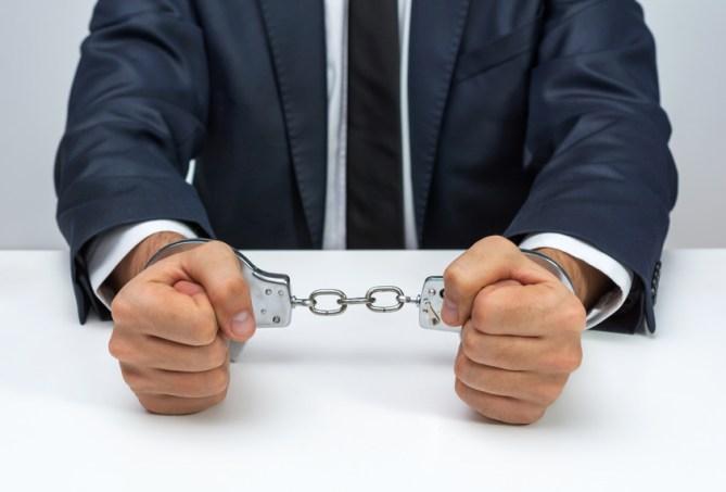 Businessman with handcuffs