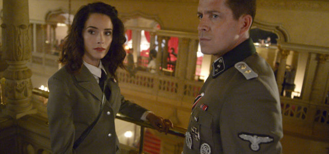 "TIMELESS -- ""Party At Castle Varlar"" Episode 103 -- Pictured: (l-r) Abigail Spencer as Lucy Preston, Sean Maguire as Ian Fleming -- (Photo by: Sergei Bachlakov/NBC)"