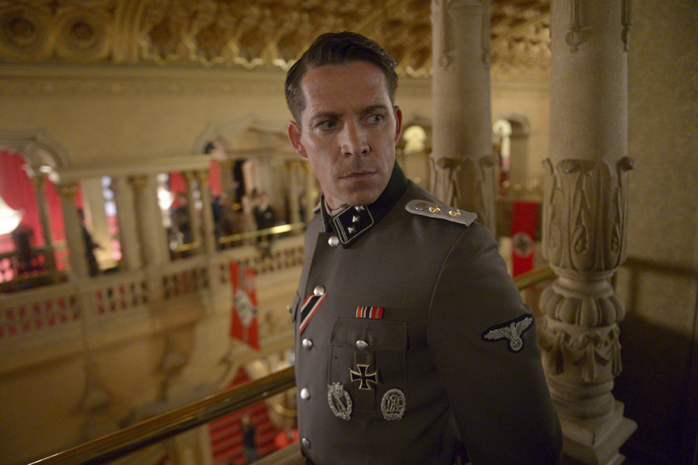 "TIMELESS -- ""Party At Castle Varlar"" Episode 103 -- Pictured: Sean Maguire as Ian Fleming -- (Photo by: Sergei Bachlakov/NBC)"