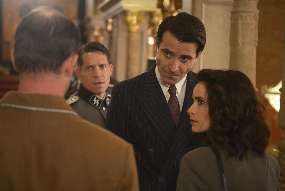 """TIMELESS -- """"Party At Castle Varlar"""" Episode 103 -- Pictured: (l-r) Sean Maguire as Ian Fleming, Goran Visnjic as Garcia Flynn, Abigail Spencer as Lucy Preston -- (Photo by: Sergei Bachlakov/NBC)"""