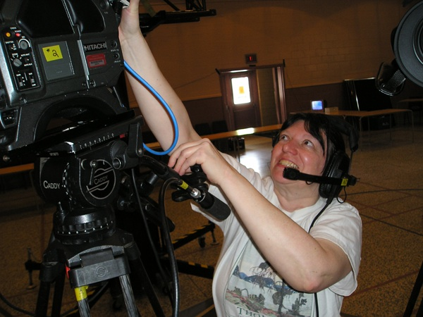 Cathi Stretching at a video camera