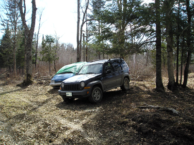 Van and Jeep at property in Quebec