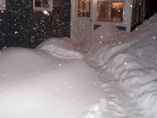 Path to door through deep snow.