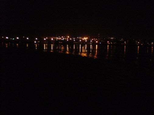 City lights refelcted on river ice.
