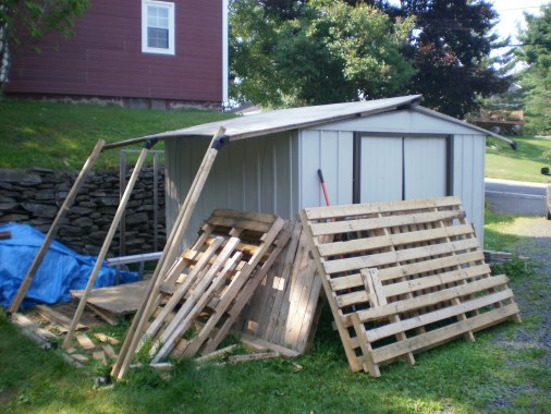 Woodshed roof is in place.