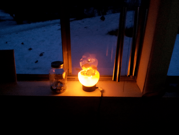 Salt Lamp On Window Sill.