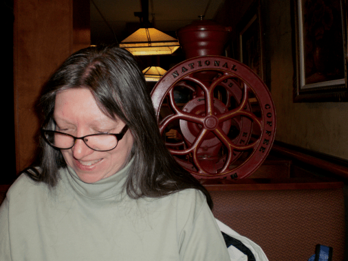 Cathi with a real coffee mill/part of one behind her.