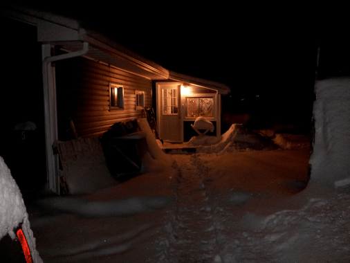 House with shoveled walk to porch. Glowing Deer eyes to the right.