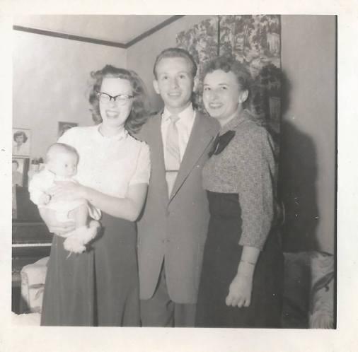Debi, Mom, Uncle Bob & Reggie in the living room at 1856 Main Street in Stratford.