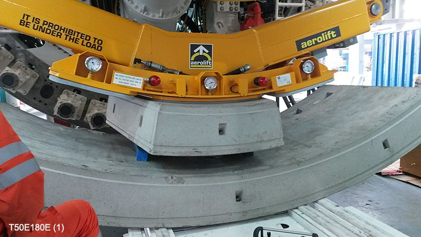 Aerolift vacuum lifter to position concrete segments inside the tunnel wall