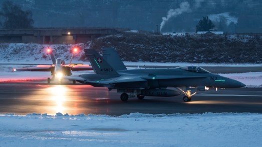 © Adam Duffield - F/A-18C Hornet pair taxis to the active runway early in the morning - World Economic Forum Air Policing