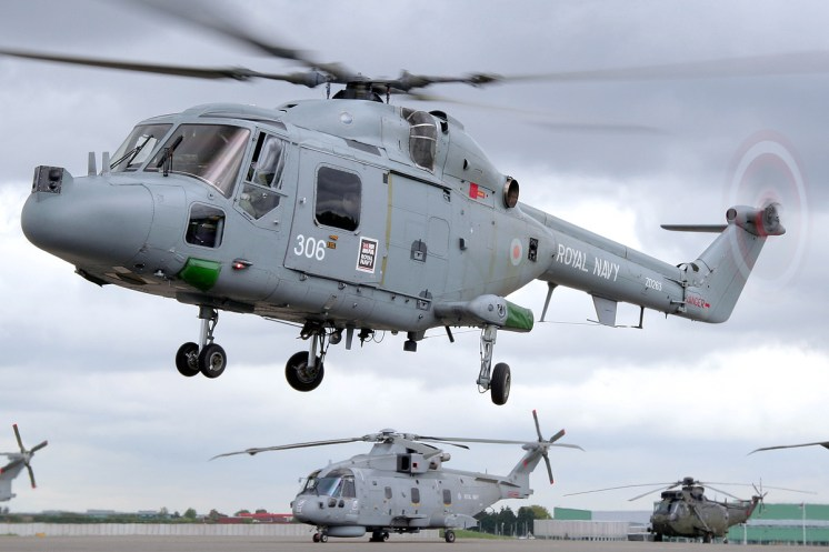 ©Mark Kwiatkowski - Lynx HMA8 in the hover with a Merlin in the background - Royal Navy Lynx Retirement