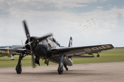© Adam Duffield - Bearcat taxiing with the Spitfire formation running in - Flying Legends 2017