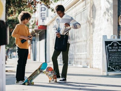 father and son skateboarders with black Aerrem bag and reusable water bottles