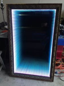 http://www.instructables.com/id/Infinity-LED-mirror/