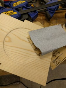 Using sand paper to hand sand edges and corners