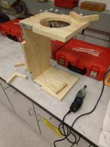 Using a dremel to create channels in wood covers over the angle brackets