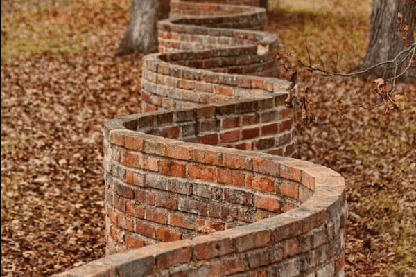 A wall that waves sinusoidally in the horizontal plane, one brick in thickness
