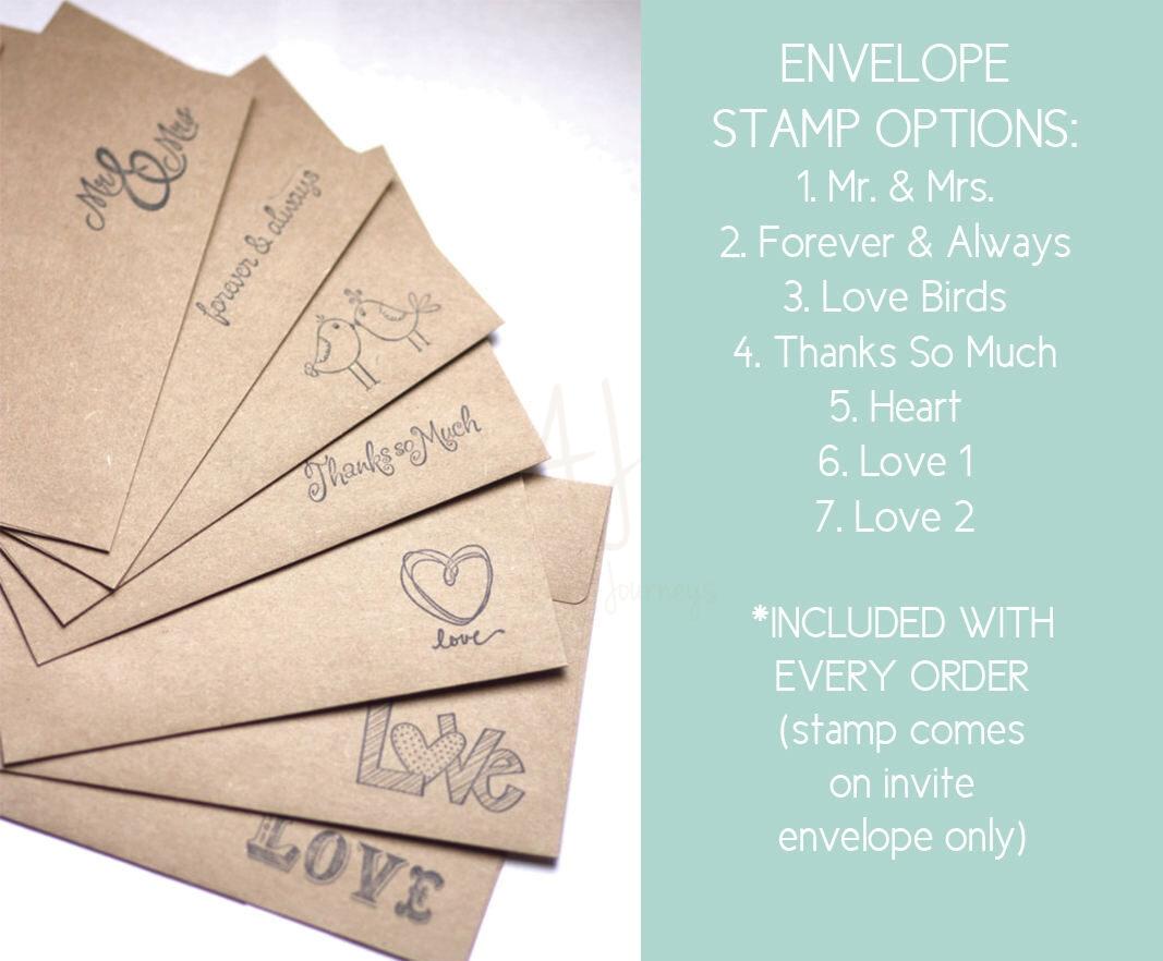 rustic wedding invite in cursive envelopes