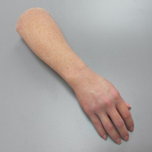 hyper realistic prosthetic arm of caucasian