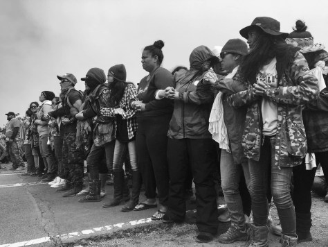 Image of Hawaiian women locking arms to protect their elders from arrest. … <a href=