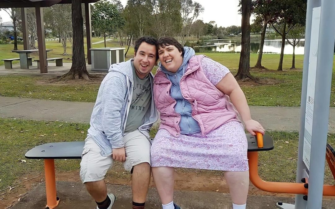 Josh and Amy on a park bench