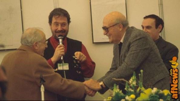 Gianfranco Goria a Lucca presenta un evwento storico - il primo incontro di Giovanbattista Carpi con Will Eisner - dietro Luca Boschi - afnews