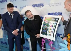 NEW YORK, NY - MARCH 18: Actors Joe Manganiello (L) and Mandy Patinkin view the Smurf stamp designs that will be available at the UN Post office as they are presented by UN OCSS Assistant-Secretary-General Stephen Cutts (R) at the United Nations Headquarters celebrating International Day of Happiness in conjunction with SMURFS: THE LOST VILLAGE on March 18, 2017 in New York City. (Photo by Cindy Ord/Getty Images for Sony Pictures)